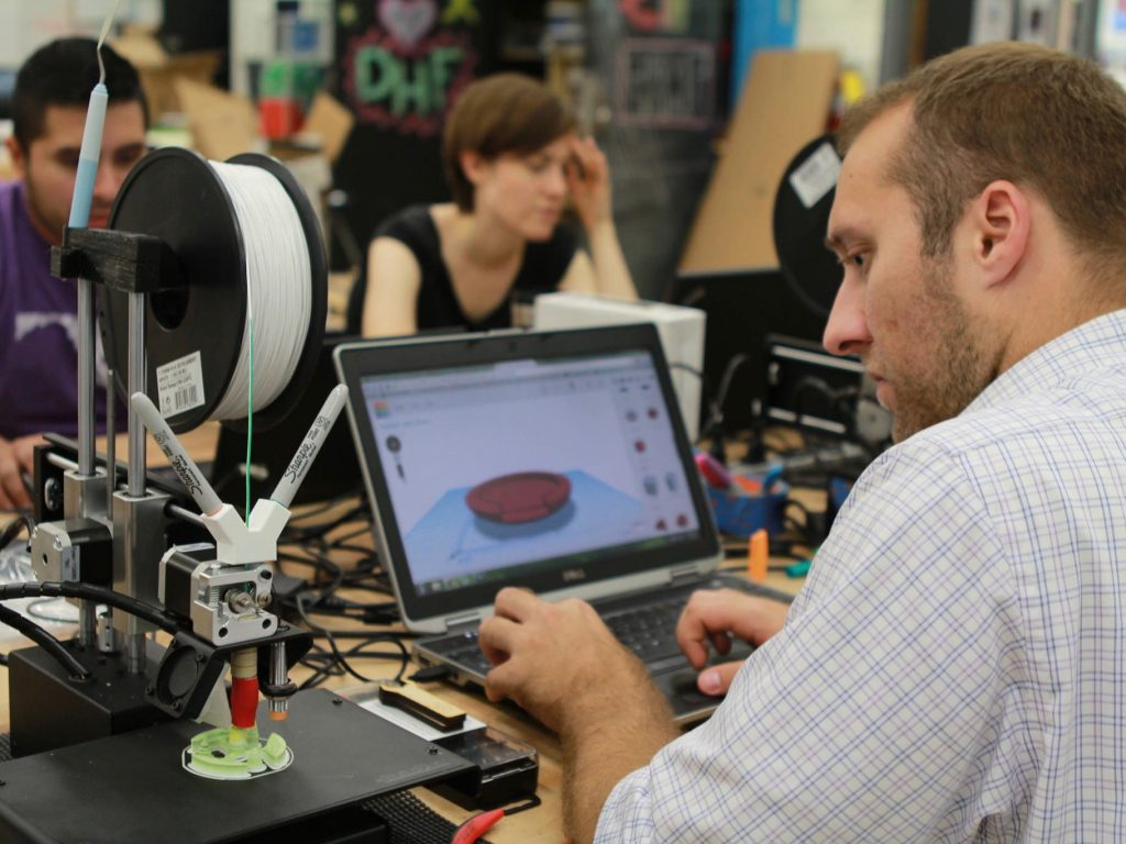 Educators working at a table with 3D printers during Digital Harbor Foundation educator workshop
