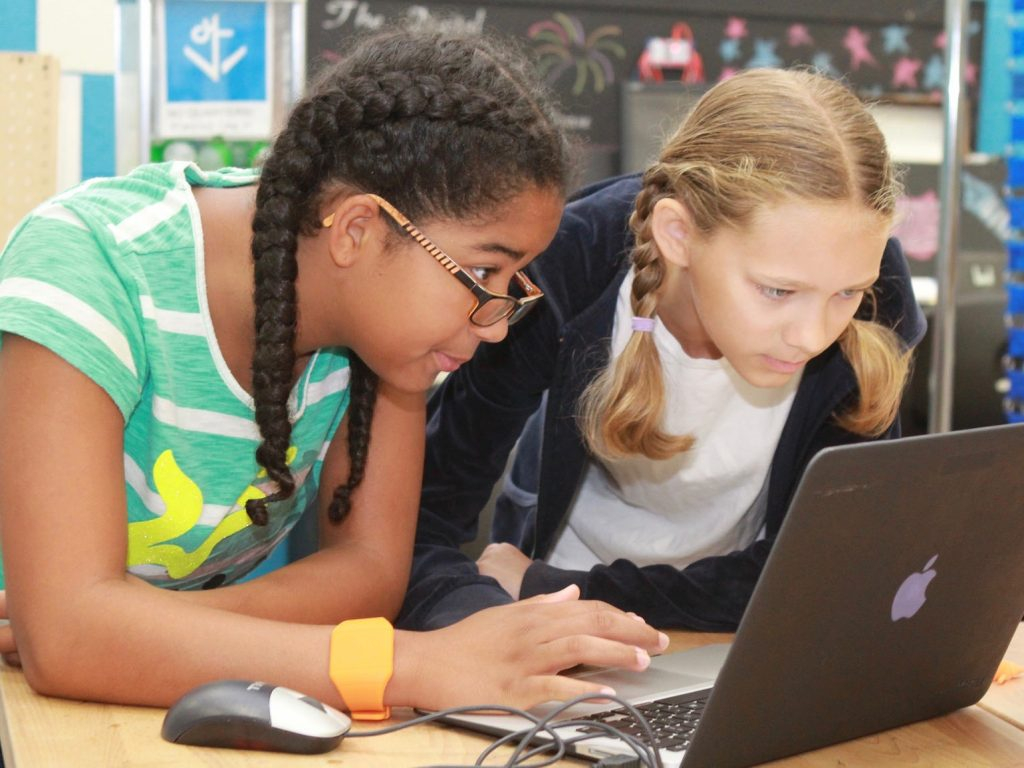 Two Digital Harbor Foundation youth working alongside each other at a computer