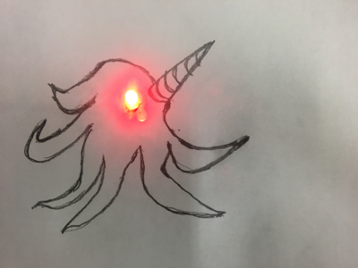 paper circuit sea monster with lit red LED eyeball