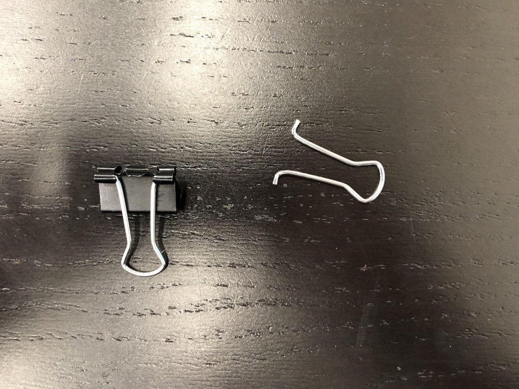binder clip with one silver clip part removed