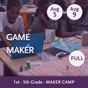 Game Maker Camp -- Youth sitting with a laptop and a board game that they created