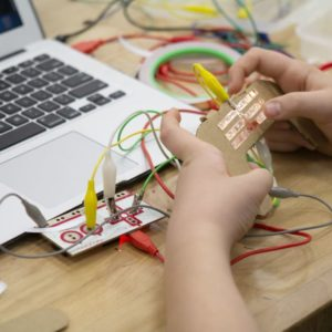 Youth with a Makey Makey and DIY controller.